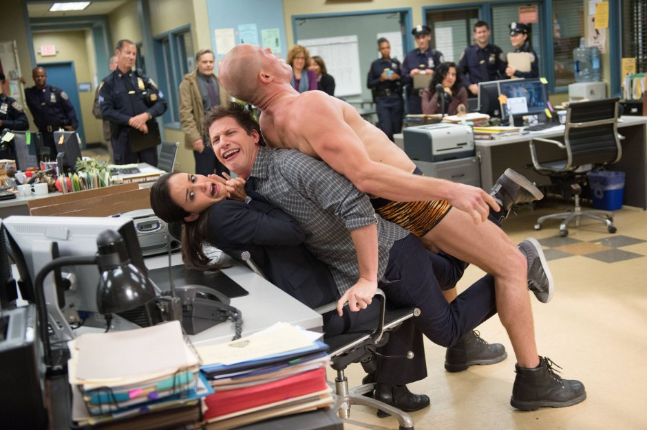 "BROOKLYN NINE-NINE: Det. Jake Peralta (Andy Samberg, C) helps Det. Amy Santiago (Melissa Fumero, L) avoid watching a strip show in the ""The Bet"" episode of BROOKLYN NINE-NINE airing Tuesday, Jan. 14 (8:30-9:00 PM ET/PT) on Fox. ©2013 Fox Broadcasting Co. CR: Eddy Chen/FOX"